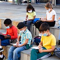 elementary students outside studying